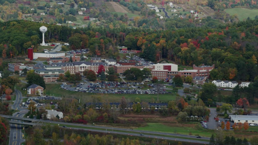 6K stock footage aerial video of White River Junction VA Medical Center, colorful trees, autumn, White River Junction, Vermont Aerial Stock Footage | AX150_473