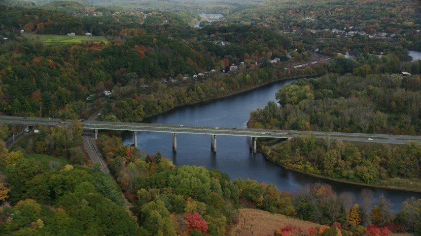 6K stock footage aerial video flying by Interstate 89, small bridge, Connecticut River, autumn, Lebanon, New Hampshire Aerial Stock Footage | AX150_474