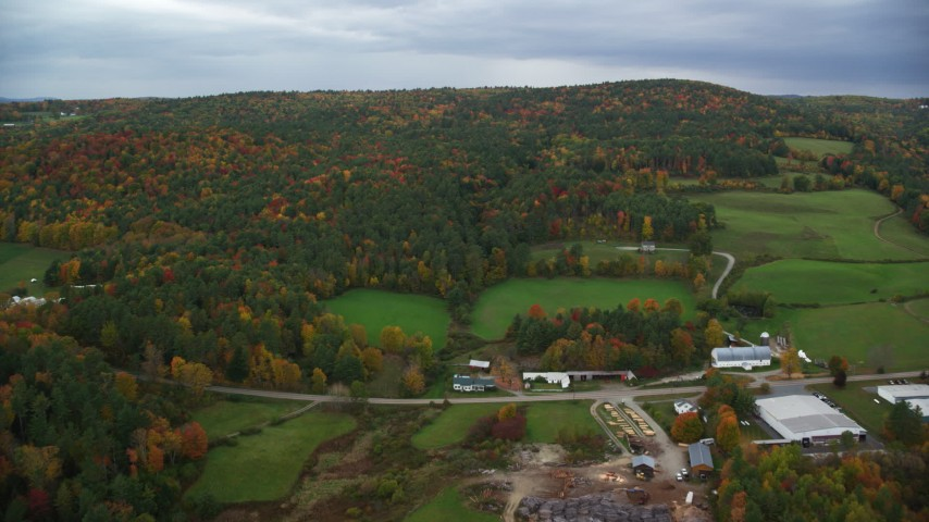 6K stock footage aerial video flying over Hartland Road, approach colorful forested hills, autumn, White River Junction, Vermont Aerial Stock Footage | AX151_001