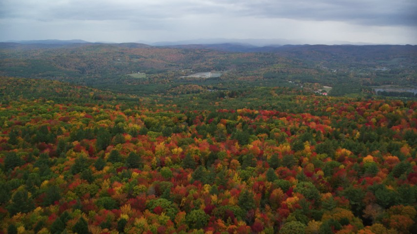6K stock footage aerial video flying over colorful, densely forested hills, overcast, autumn, Quechee, Vermont Aerial Stock Footage | AX151_004