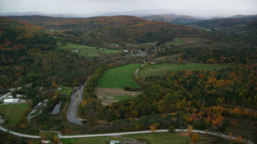 6K stock footage aerial video flying over Woodstock Road, approach a small rural town, autumn, Taftsville, Vermont Aerial Stock Footage | AX151_008