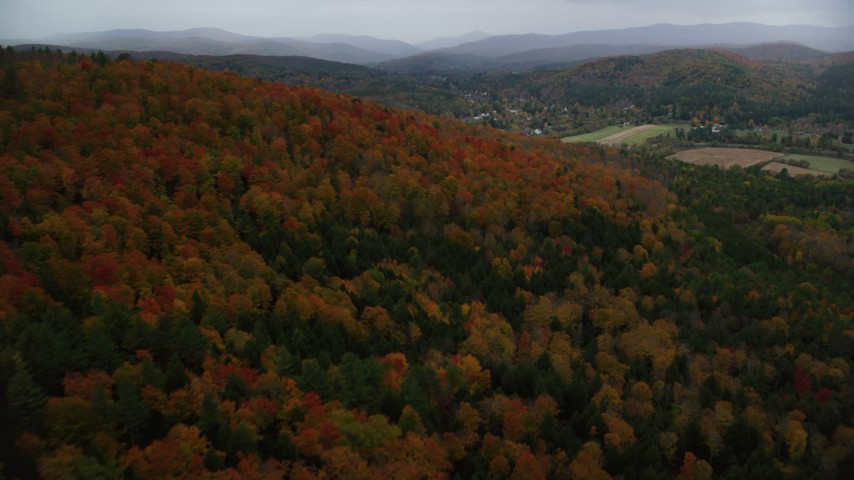6K stock footage aerial video flying over forest, Blake Hill, reveal, small rural town, autumn, Woodstock, Vermont Aerial Stock Footage | AX151_011
