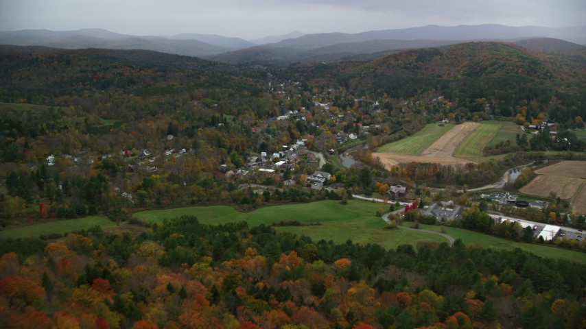 6K stock footage aerial video approaching Ottauquechee River, small rural town, autumn, Woodstock, Vermont Aerial Stock Footage | AX151_012