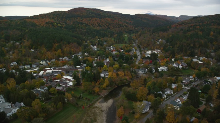 6K stock footage aerial video orbiting Ottauquechee River through small rural town, autumn, Woodstock, Vermont Aerial Stock Footage | AX151_015