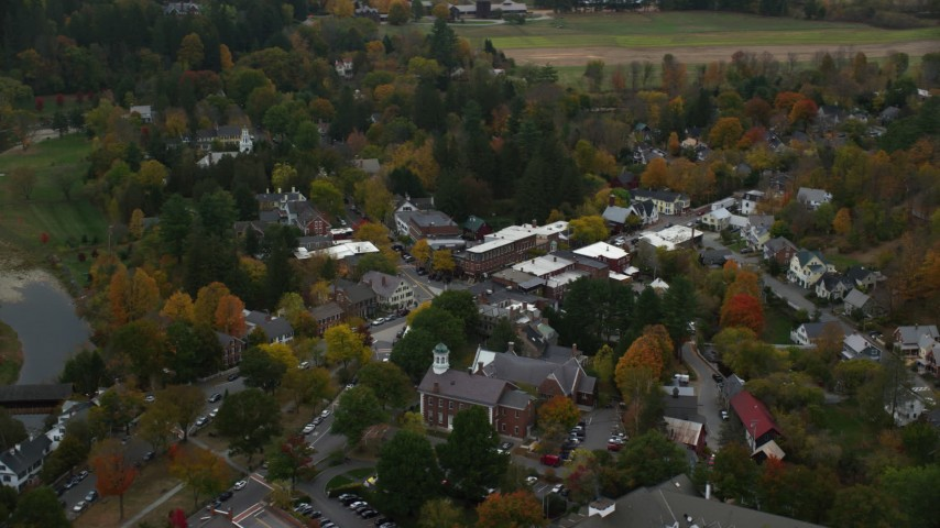 6K stock footage aerial video orbiting small rural town with colorful foliage in autumn, Woodstock, Vermont Aerial Stock Footage | AX151_017