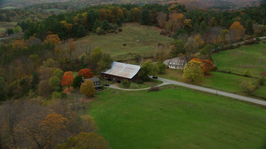6K stock footage aerial video orbiting small farm, barn, grass clearings, colorful foliage in autumn, Taftsville, Vermont Aerial Stock Footage | AX151_033