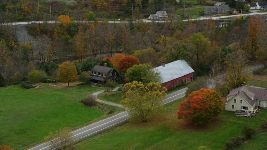 6K stock footage aerial video orbiting a small farm and barn, colorful foliage, autumn, Taftsville, Vermont Aerial Stock Footage | AX151_034