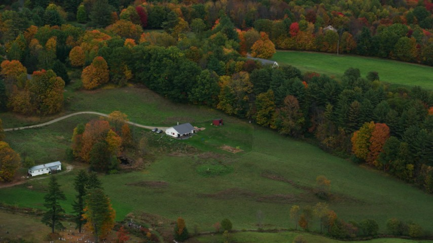 6K stock footage aerial video flying by a small farm, colorful trees, autumn, Hartland, Vermont Aerial Stock Footage | AX151_043