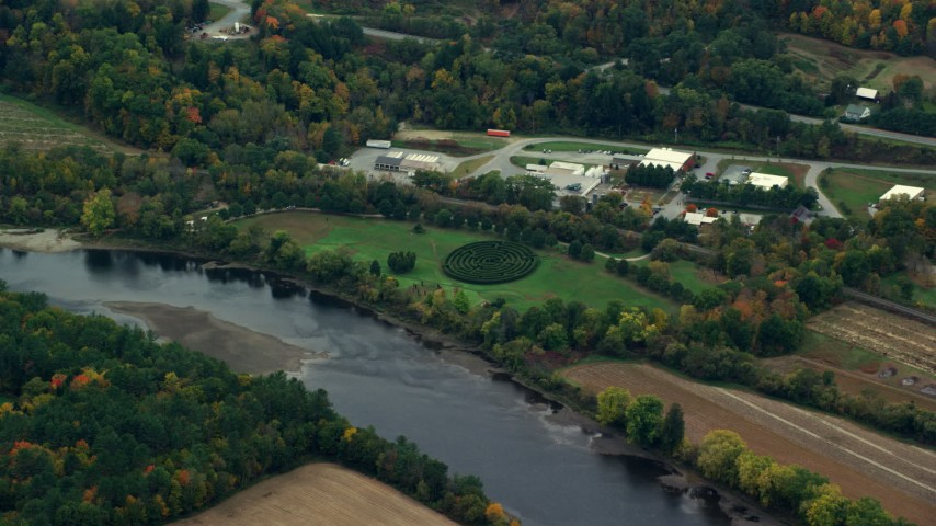 6K stock footage aerial video flying by hedge maze, park along Connecticut River, autumn, Hartland, Vermont Aerial Stock Footage | AX151_048