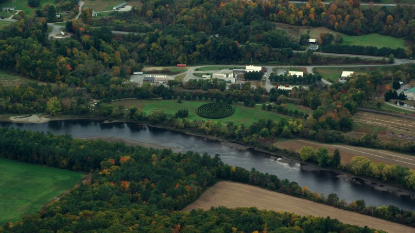 6K stock footage aerial video flying away from hedge maze, park near Connecticut River, autumn, Hartland, Vermont Aerial Stock Footage | AX151_049