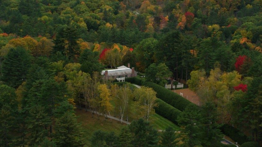 6K stock footage aerial video flying by an isolated mansion, colorful trees in autumn, Cornish, New Hampshire Aerial Stock Footage | AX151_052