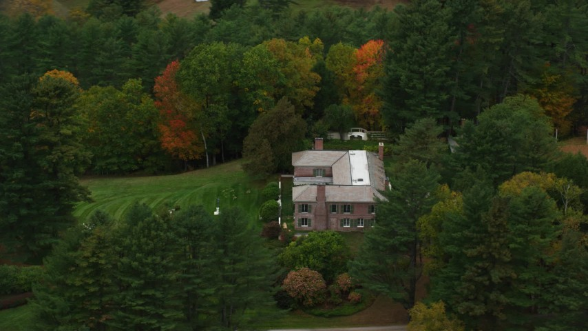 6K stock footage aerial video orbiting an isolated mansion, colorful trees in autumn, Cornish, New Hampshire Aerial Stock Footage | AX151_053