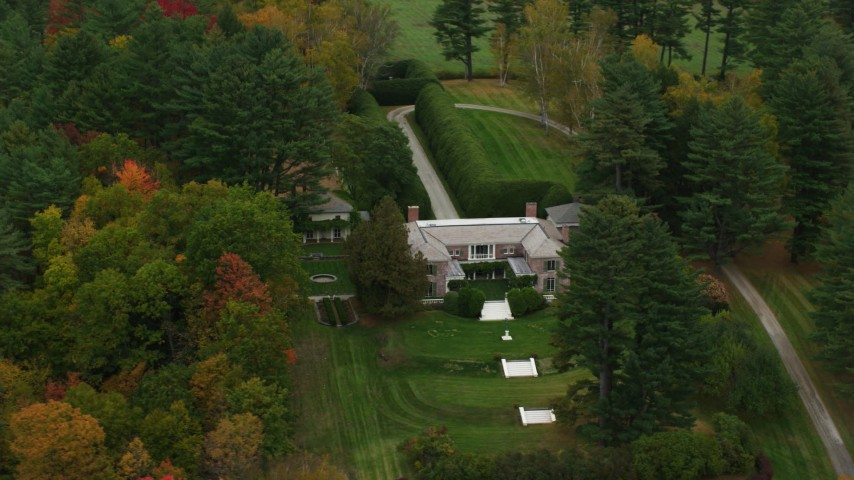 6K stock footage aerial video orbiting an isolated mansion and colorful trees, autumn, Cornish, New Hampshire Aerial Stock Footage | AX151_054