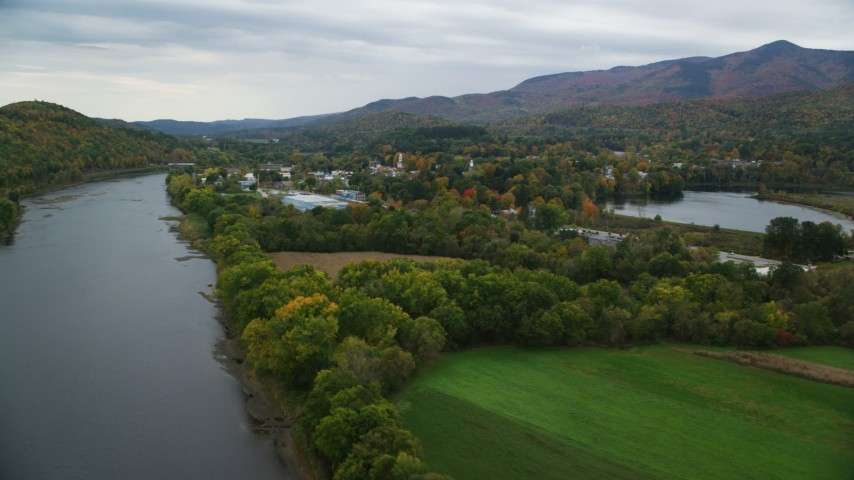 6K stock footage aerial video flying by small rural town near the Connecticut River, autumn, Windsor, Vermont Aerial Stock Footage | AX151_056