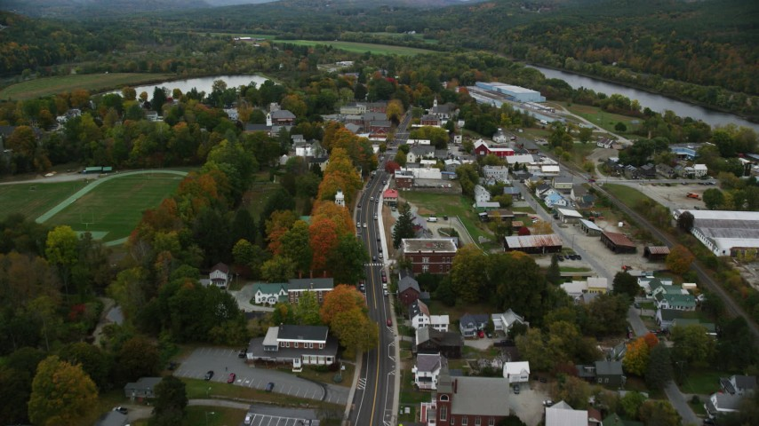 6K stock footage aerial video flying over Main Street through small rural town, autumn, Windsor, Vermont Aerial Stock Footage | AX151_061
