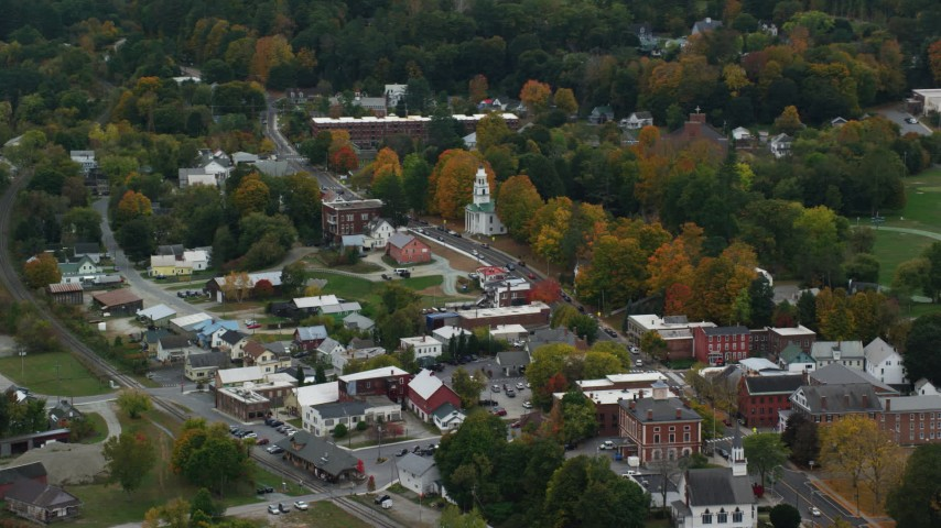 6K stock footage aerial video flying by a small rural town, brightly colored foliage, autumn, Windsor, Vermont Aerial Stock Footage | AX151_063
