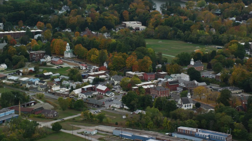 6K stock footage aerial video flying by small rural town, colorful trees, autumn, overcast, Windsor, Vermont Aerial Stock Footage | AX151_064