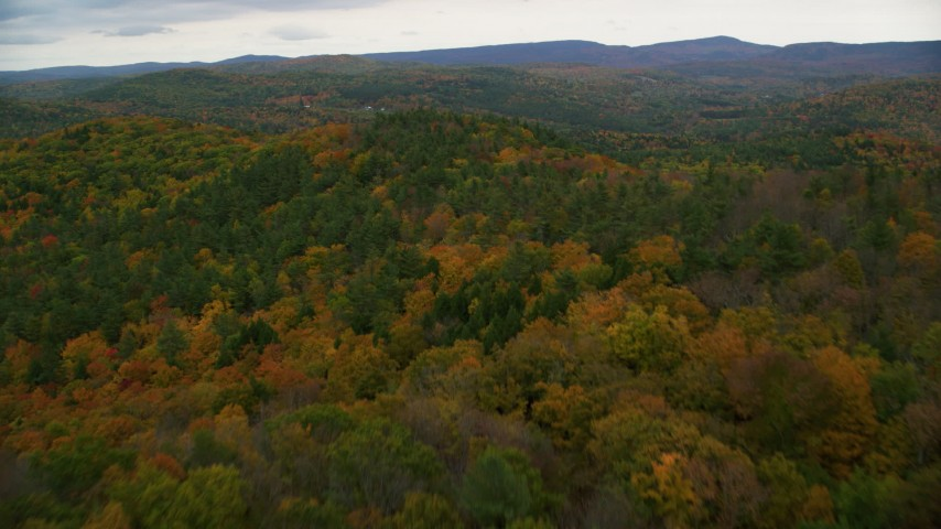 6K stock footage aerial video flying over colorful forest, hills, revealing farms, autumn, Cornish, New Hampshire Aerial Stock Footage | AX151_065