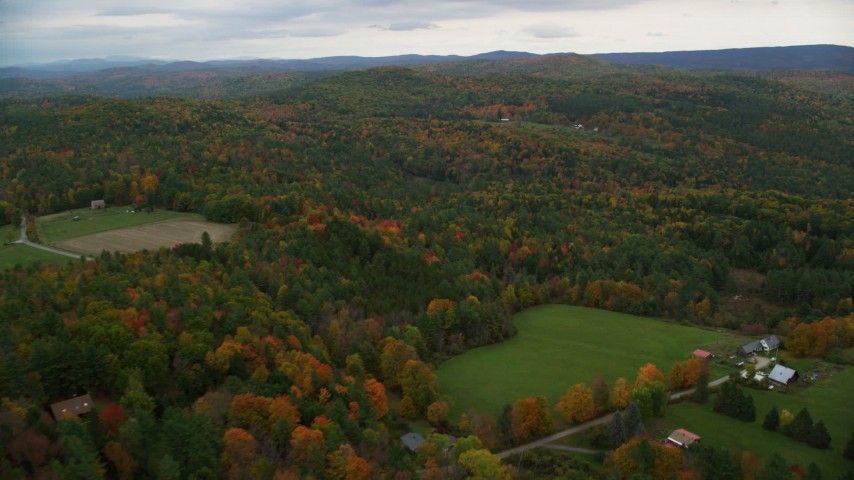 6K stock footage aerial video flying by farms, pan right, fly by colorful forest, autumn, Cornish, New Hampshire Aerial Stock Footage | AX151_066