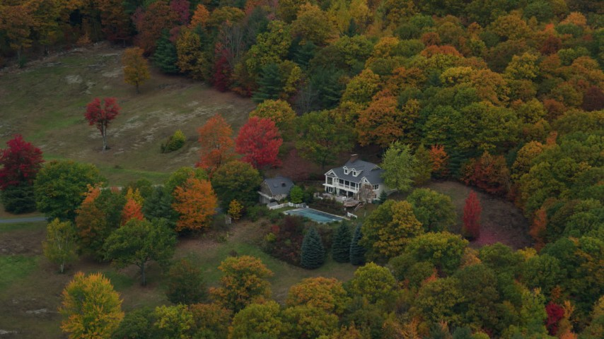 6K stock footage aerial video flying away from isolated homes, brightly colored trees, autumn, Cornish, New Hampshire Aerial Stock Footage | AX151_068