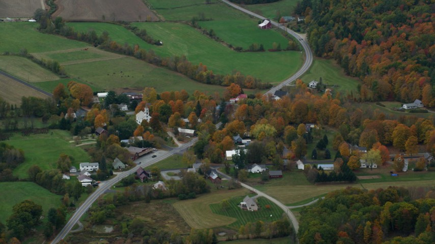 6K stock footage aerial video flying by small rural town, grassy clearings, foliage, autumn, Cornish, New Hampshire Aerial Stock Footage | AX151_069