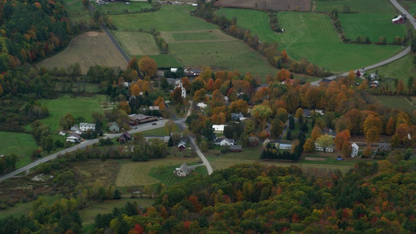 6K stock footage aerial video flying by small rural town, colorful foliage, autumn, Cornish, New Hampshire Aerial Stock Footage | AX151_070