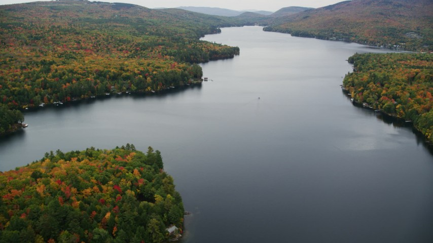 6K stock footage aerial video flying over waterfront homes, colorful forest, Lake Sunapee, autumn, Newbury, New Hampshire Aerial Stock Footage | AX151_084