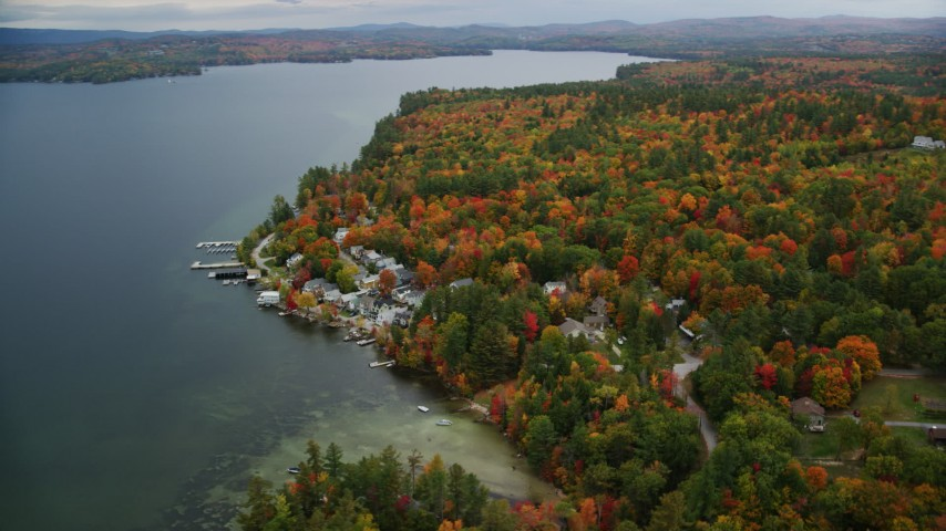 6K stock footage aerial video orbiting waterfront homes, Lake Sunapee, forest, autumn, Newbury, New Hampshire Aerial Stock Footage | AX151_086