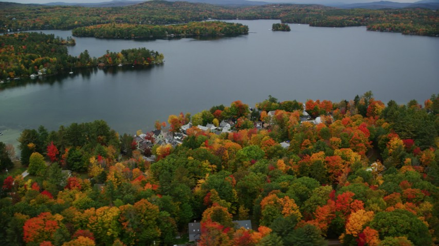 6K stock footage aerial video orbiting waterfront homes, colorful foliage, Lake Sunapee, autumn, Newbury, New Hampshire Aerial Stock Footage | AX151_087