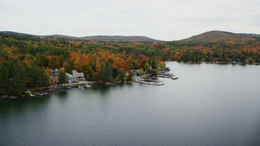 6K stock footage aerial video orbiting waterfront homes, forest, Lake Sunapee, autumn, Newbury, New Hampshire Aerial Stock Footage | AX151_089