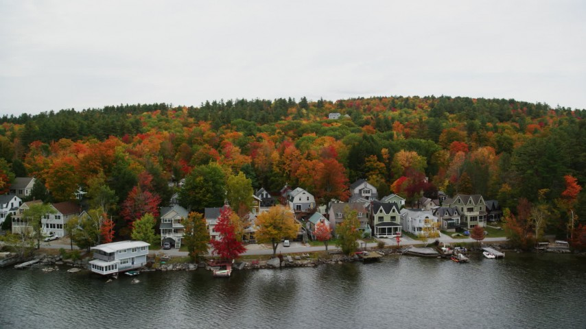 6K stock footage aerial video flying over Lake Sunapee and by waterfront homes, autumn, Newbury, New Hampshire Aerial Stock Footage | AX151_090