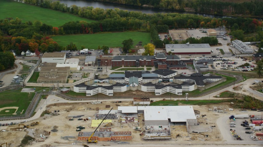 6K stock footage aerial video orbiting the New Hampshire State Prison, autumn, Concord, New Hampshire Aerial Stock Footage | AX151_159