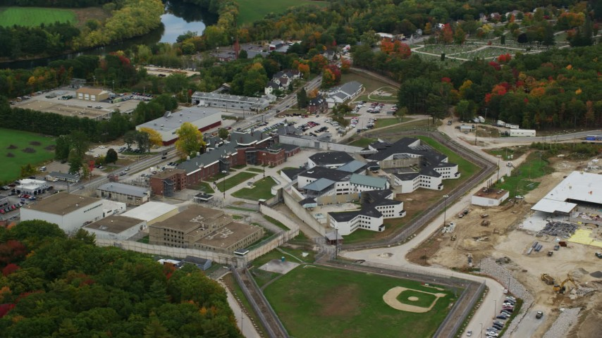 6K stock footage aerial video orbiting New Hampshire State Prison, baseball field, autumn, Concord, New Hampshire Aerial Stock Footage | AX151_160