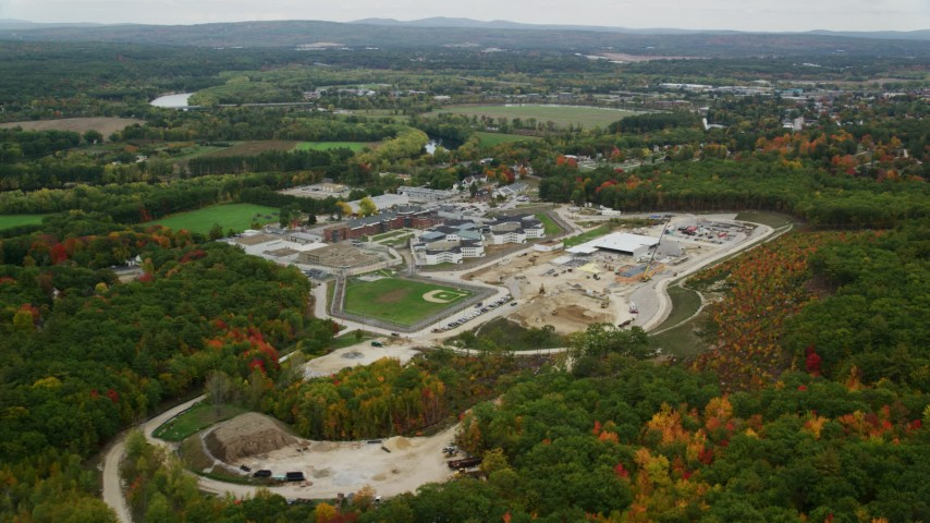 6K stock footage aerial video flying by New Hampshire State Prison, autumn, Concord, New Hampshire Aerial Stock Footage | AX151_171