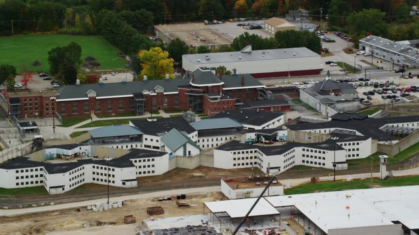 6K stock footage aerial video flying by the New Hampshire State Prison in autumn, Concord, New Hampshire Aerial Stock Footage | AX151_172