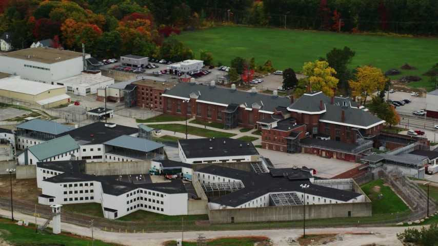 6K stock footage aerial video orbiting the New Hampshire State Prison, autumn, Concord, New Hampshire Aerial Stock Footage | AX151_173