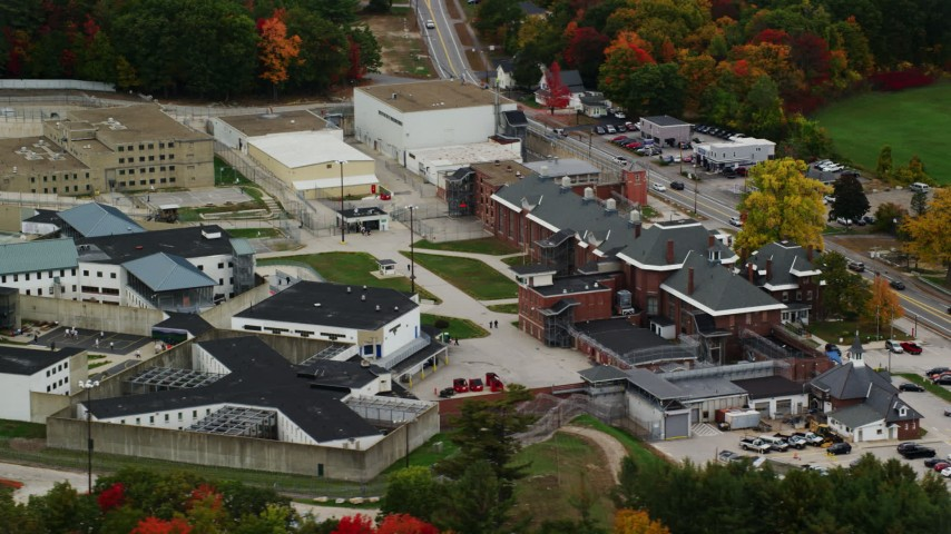 6K stock footage aerial video orbiting the New Hampshire State Prison, colorful foliage, autumn, Concord, New Hampshire Aerial Stock Footage | AX151_174