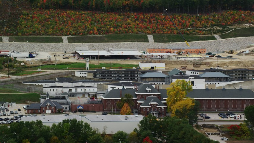6K stock footage aerial video orbiting the New Hampshire State Prison, light traffic, autumn, Concord, New Hampshire Aerial Stock Footage | AX151_177