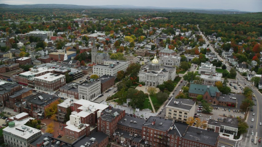 6K stock footage aerial video orbiting St Paul's Church, New Hampshire State House, downtown, autumn, Concord, New Hampshire  Aerial Stock Footage | AX151_181