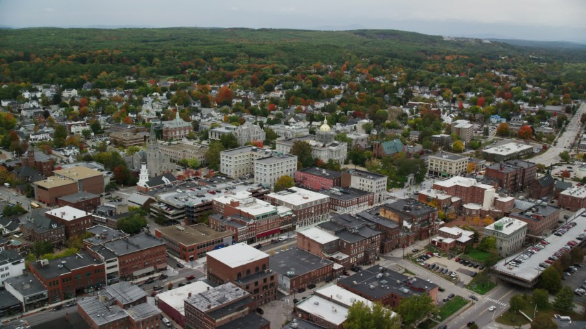 6K stock footage aerial video orbiting New Hampshire State House, Main Street, downtown, autumn, Concord, New Hampshire Aerial Stock Footage | AX151_182