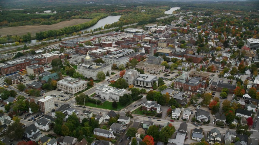 6K stock footage aerial video orbiting the New Hampshire State House, downtown in autumn, Concord, New Hampshire Aerial Stock Footage | AX151_185