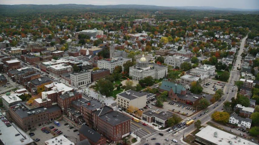 6K stock footage aerial video orbiting New Hampshire State House, downtown in autumn, Concord, New Hampshire Aerial Stock Footage | AX151_187