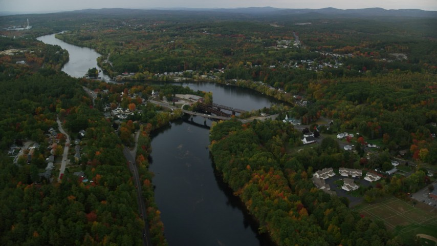 6K stock footage aerial video orbiting small bridges, Merrimack River, small town, autumn, Hooksett, New Hampshire Aerial Stock Footage AX152_012