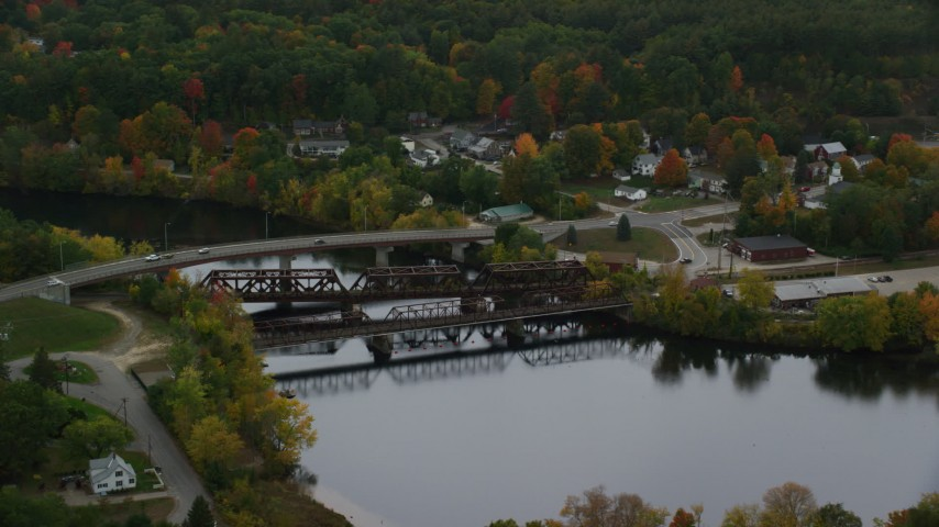 6K stock footage aerial video orbiting small bridges, Merrimack River, autumn, Hooksett, New Hampshire Aerial Stock Footage | AX152_014