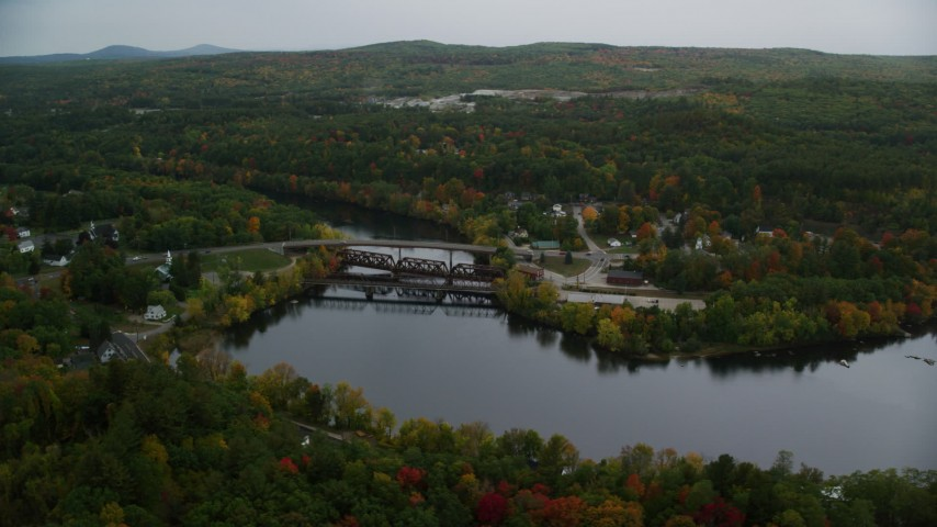 6K stock footage aerial video orbiting small town, homes, small bridges, Merrimack River, autumn, Hooksett, New Hampshire Aerial Stock Footage | AX152_015