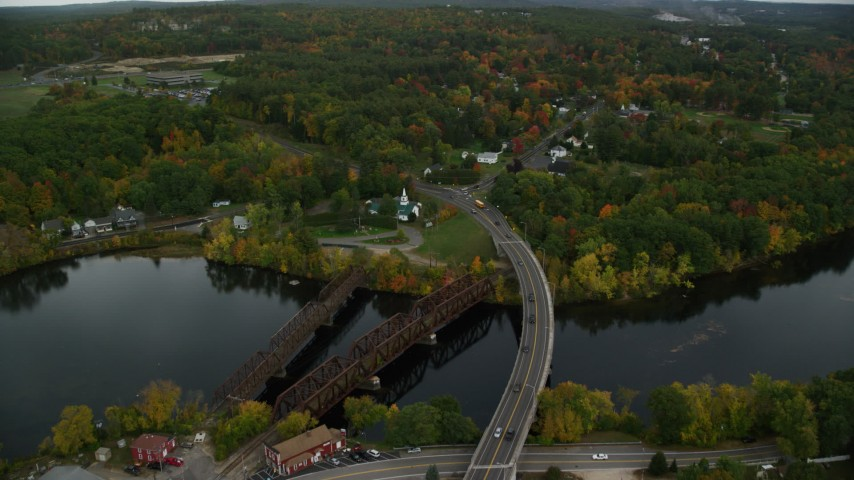 6K stock footage aerial video flying over Merrimack River, College Park Road through small town, autumn, Hooksett, New Hampshire Aerial Stock Footage | AX152_017