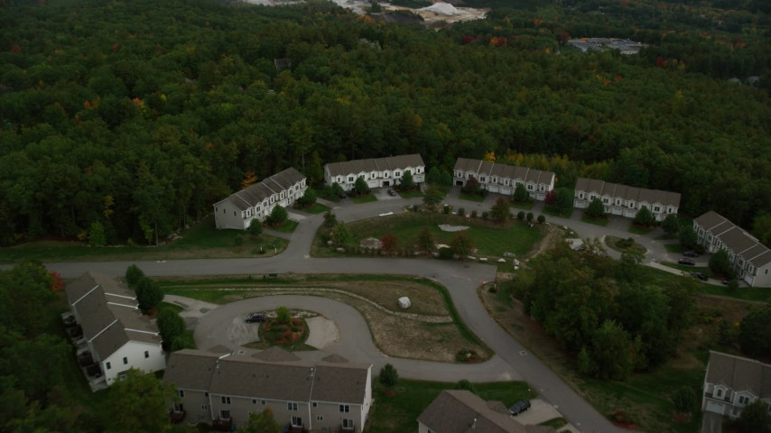 6K stock footage aerial video approaching condominiums and tilt down, autumn, Hooksett, New Hampshire Aerial Stock Footage | AX152_022