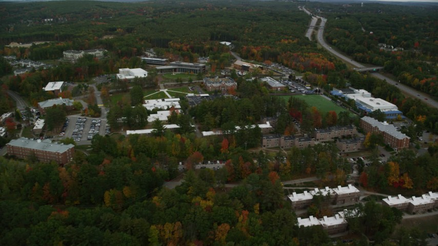 6K stock footage aerial video flying over Southern New Hampshire University, pan left, autumn, Hooksett, New Hampshire Aerial Stock Footage | AX152_033