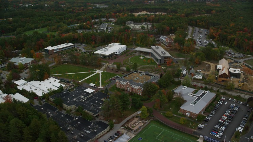 6K stock footage aerial video  flying by Southern New Hampshire University, autumn, Hooksett, New Hampshire Aerial Stock Footage | AX152_034