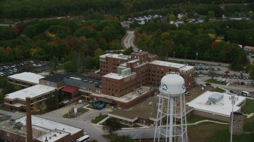 6K stock footage aerial video flying by Veterans Affairs Medical Center, autumn, Manchester, New Hampshire Aerial Stock Footage | AX152_036